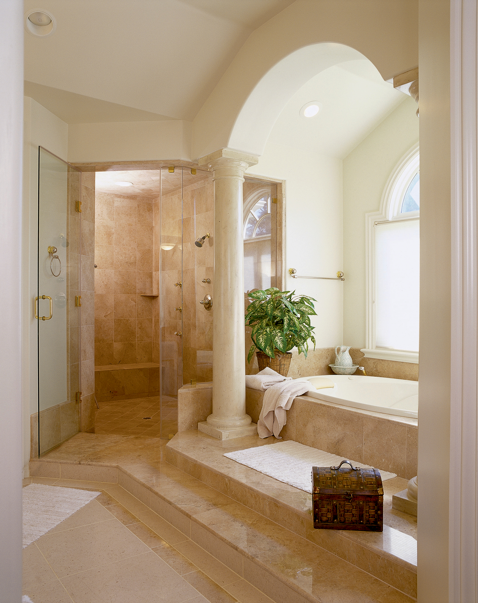 Luxury master bath featuring custom tile & marble
