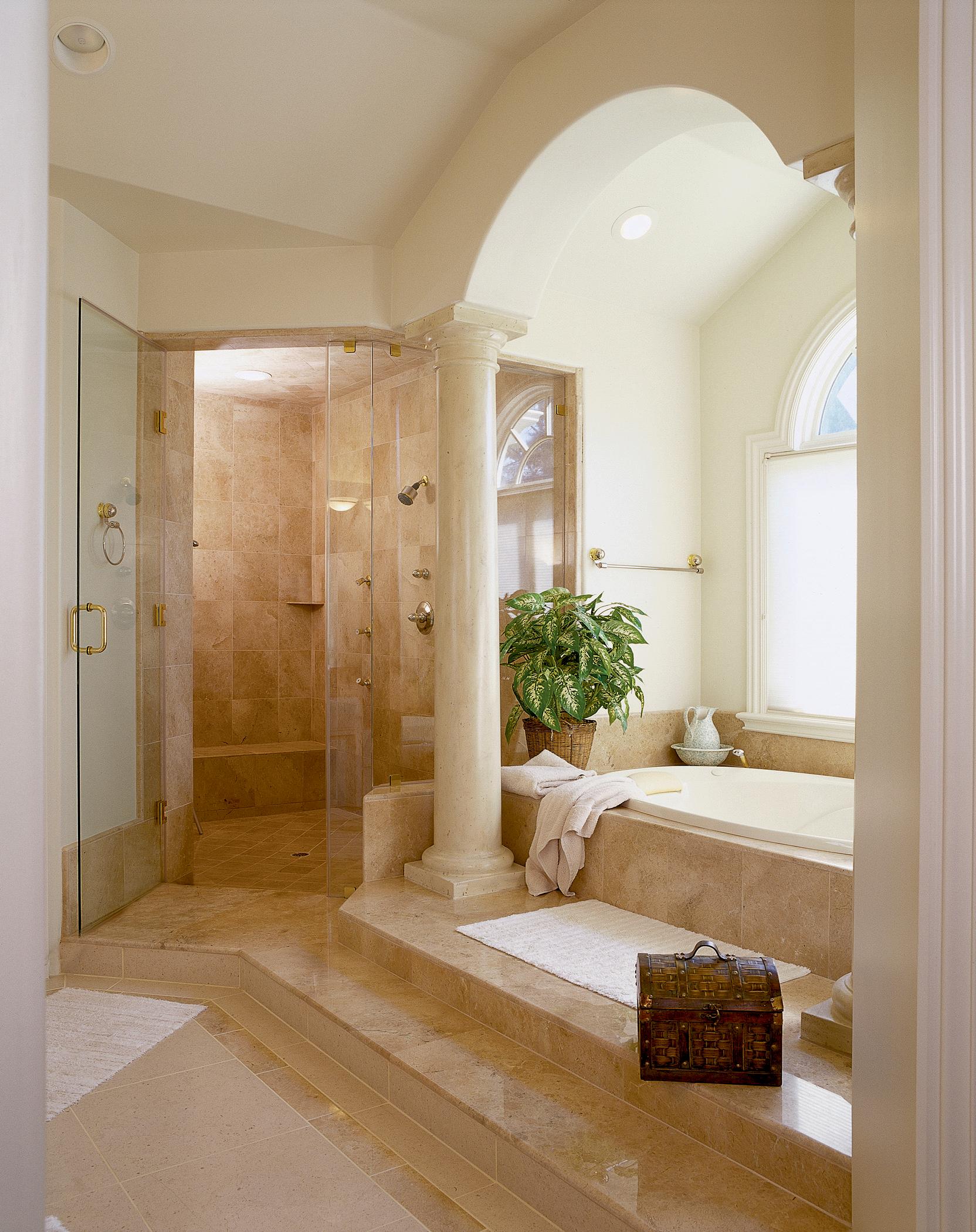 Luxury master bath featuring custom tile & marble